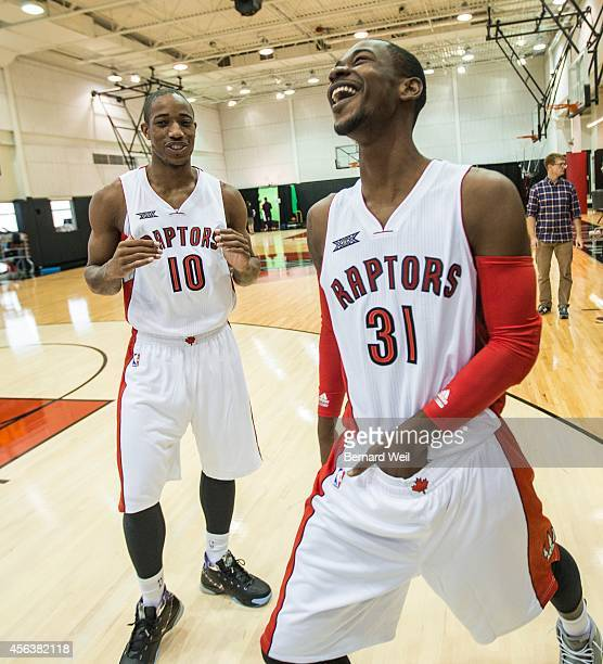 Raptors DeMar DeRozan and Terrence Ross share a laugh during a photo shoot on the team's practise court Players and coaching staff had official...