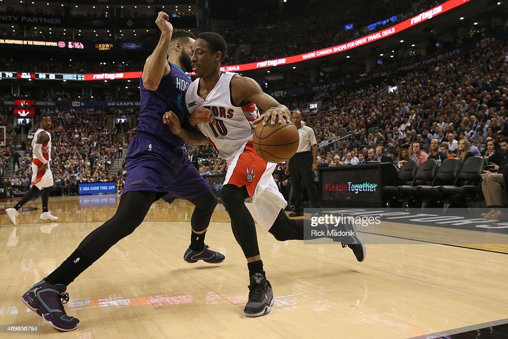 TORONTO APRIL 15 Raptors DeMar DeRozan drives the baseline against Charlotte's Jeff Taylor Toronto Raptors vs Charlotte Hornets during 2nd half...