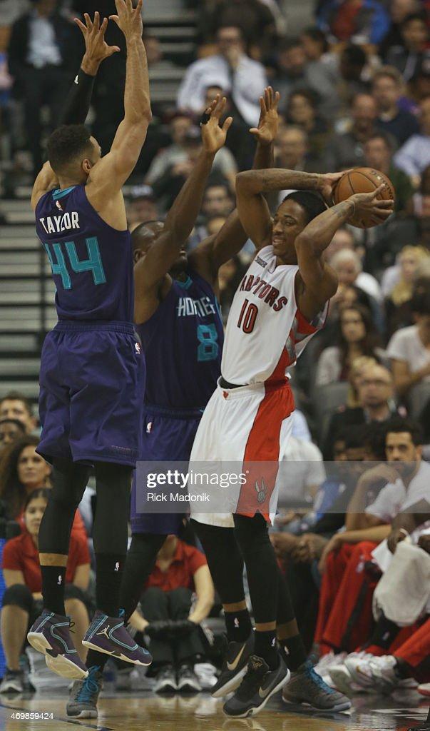 TORONTO APRIL 15 Raptors DeMar DeRozan is double teamed against the sideline by Charlotte's Jeff Taylor and Bismack Biyombo Toronto Raptors vs...