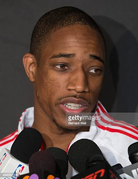 Raptors DeMar DeRozan talks to the media in a scrum Players and coaching staff had official photos taken and met with the media at the Real Sports Bar