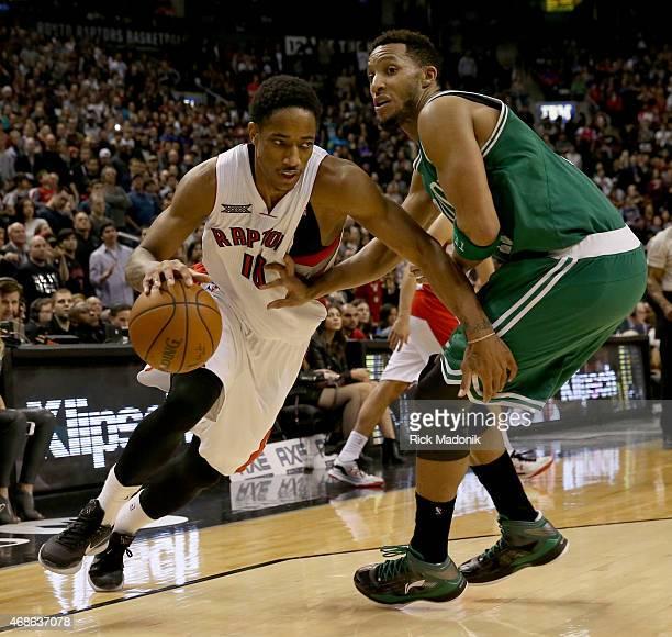 TORONTO APRIL 4 Raptors DeMar DeRozan turns the corner on Toronto Raptors vs Boston Celtics Evan Turner in 2ndhalf action of NBA regular season play...