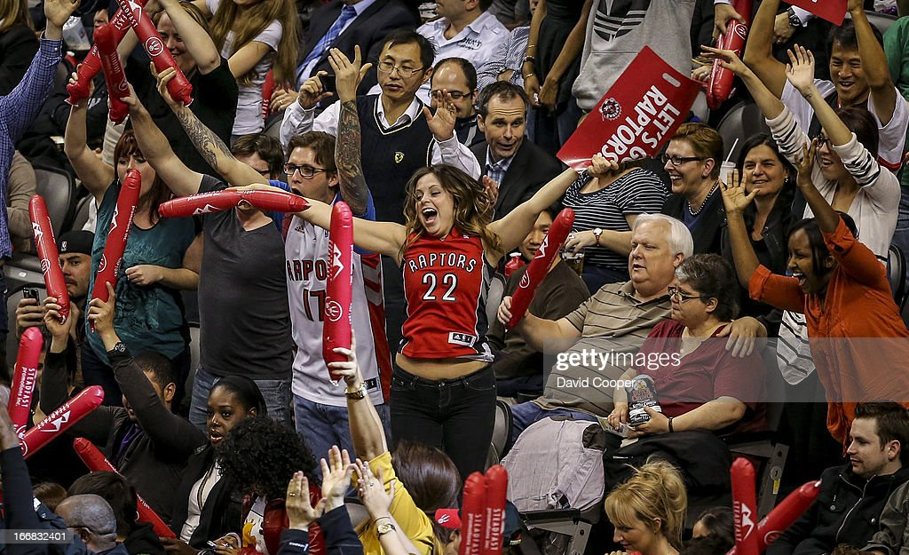 TORONTO, ON - Raptors fans cheer for their team (and free T-shirts) during the game between the Toronto Raptors and the Boston Celtics APRIL