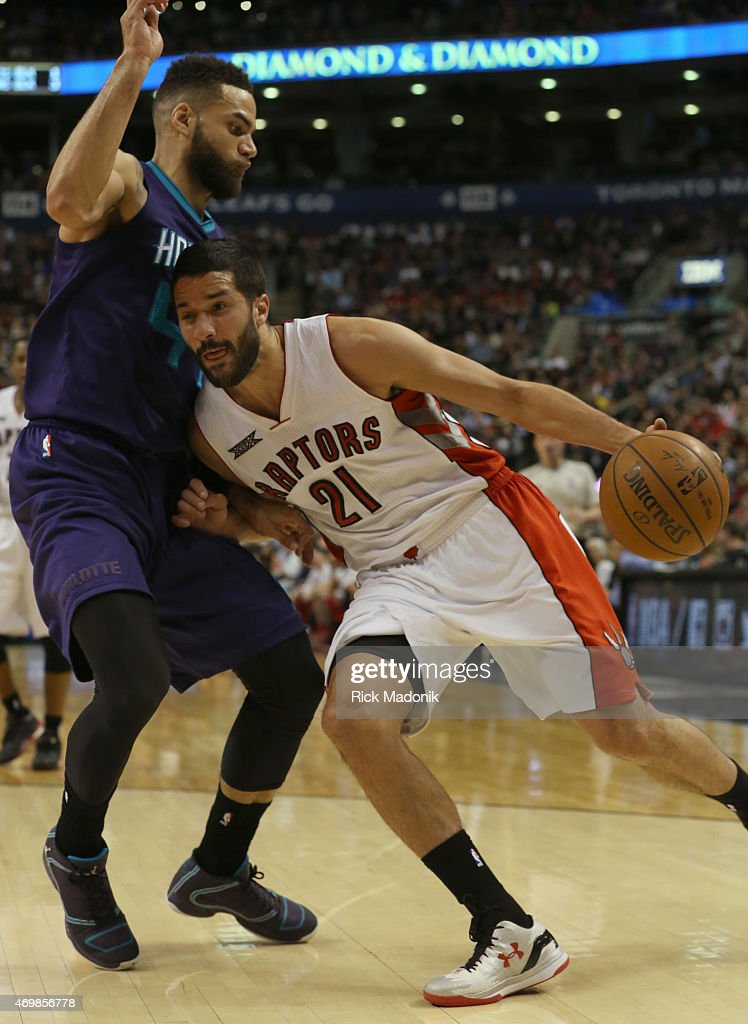 TORONTO APRIL 15 Raptors Greivis Vasquez drives the baseline against Charlotte's Jeff Taylor Toronto Raptors vs Charlotte Hornets during 2nd half...