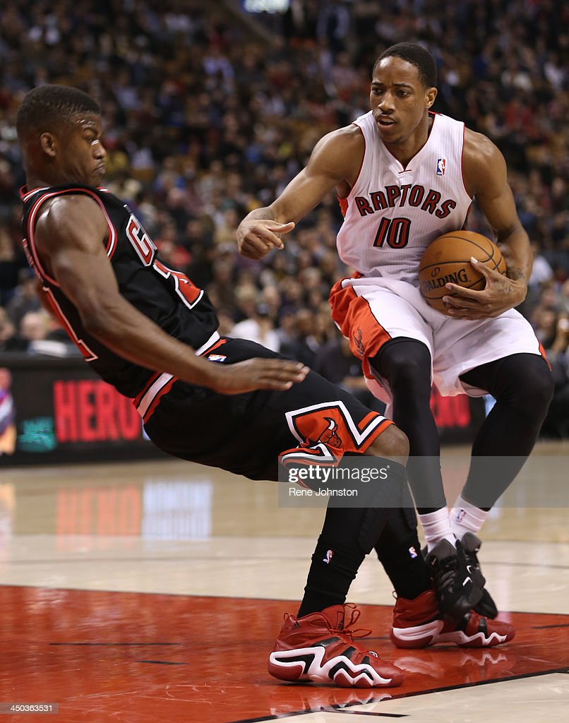 Raptors guard DeMar DeRozan draws the foul off <a gi-track='captionPersonalityLinkClicked' href=/galleries/search?phrase=Jimmy+Butler+-+Basketball+Player&family=editorial&specificpeople=9860567 ng-click='$event.stopPropagation()'>Jimmy Butler</a> of Chicago at theAir Canada Centre in Toronto, November 15, 2013. DeRozan had a career high 37 points.