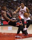 Raptors guard DeMar DeRozan draws the foul off Jimmy Butler of Chicago at theAir Canada Centre in Toronto November 15 2013 DeRozan had a career high...