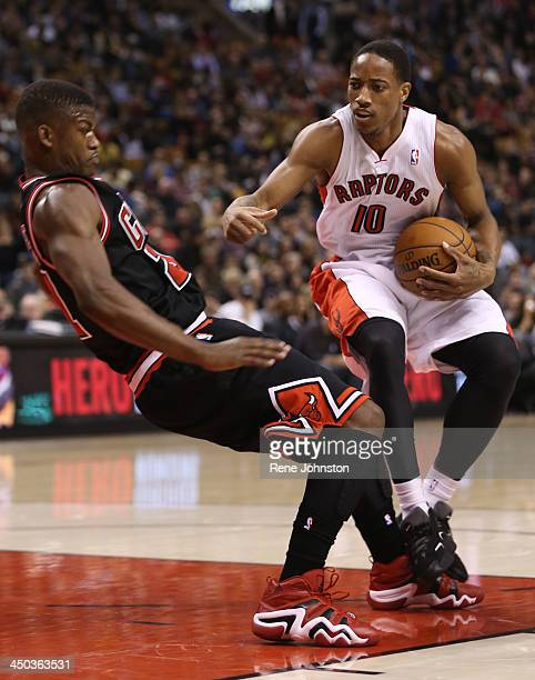 Raptors guard DeMar DeRozan draws the foul off Jimmy Butler of Chicago at theAir Canada Centre in Toronto November 15 2013 DeRozan had a career high...