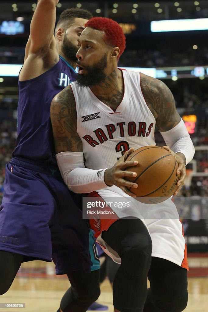 TORONTO APRIL 15 Raptors James Johnson works the baseline against Charlotte's Jeff Taylor Toronto Raptors vs Charlotte Hornets during 2nd half action...