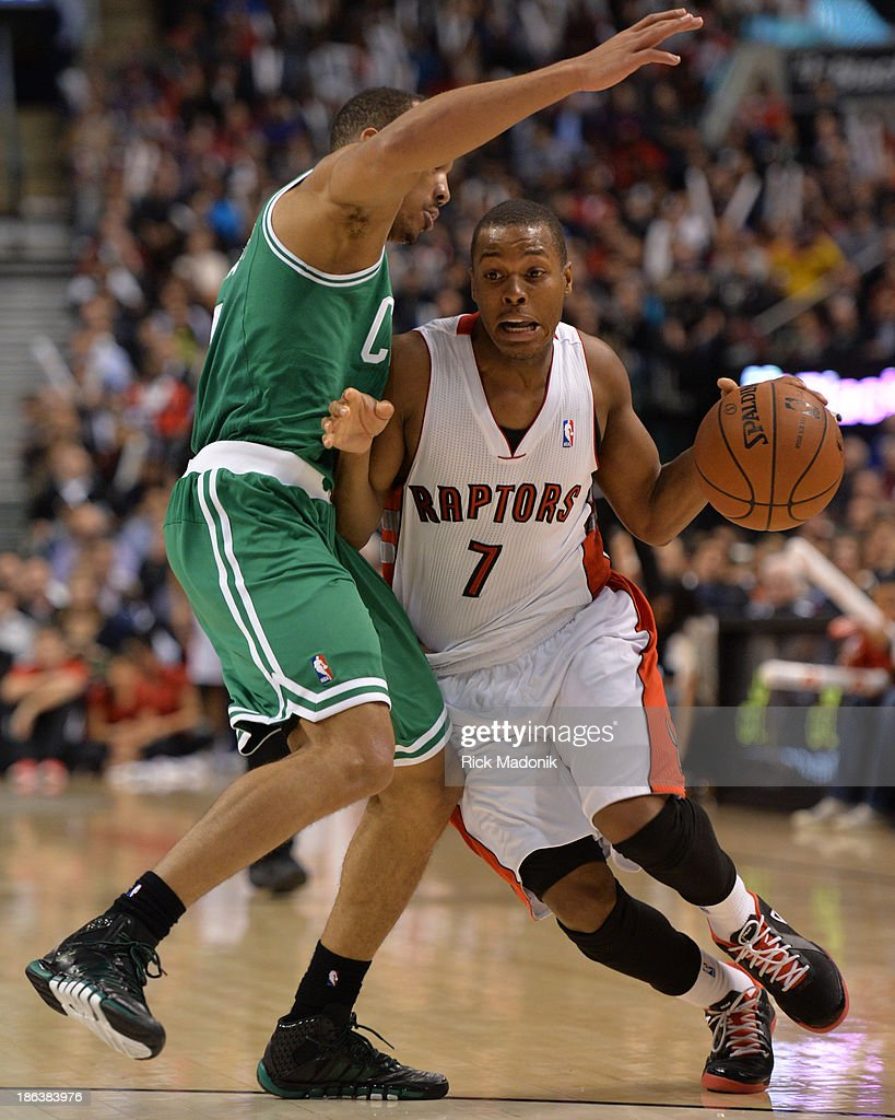 TORONTO - OCTOBER 30 - Raptors Kyle Lowry drives past a defender. Toronto Raptors host Boston Celtics at the Air Canada Centre as Toronto opens the 2013-14 NBA season at home on October 30, 2013. Raptors win 93-87.