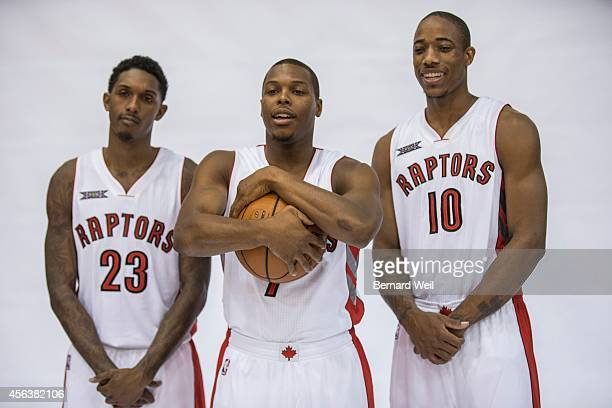 Raptors Lou Williams Kyle Lowry and DeMar DeRozan smile for the cameras during a photo shoot on the team's practise court Players and coaching staff...