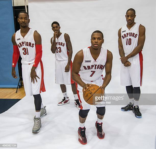 Raptors Terrence Ross Lou Williams Kyle Lowry and DeMar DeRozan during a photo shoot on the team's practise court Players and coaching staff had...