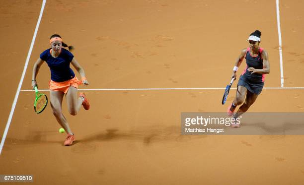 Raquel Atawo of the United States and Jelena Ostapenko of Latvia in action during the doubles final against Abigail Spears of the United States and...