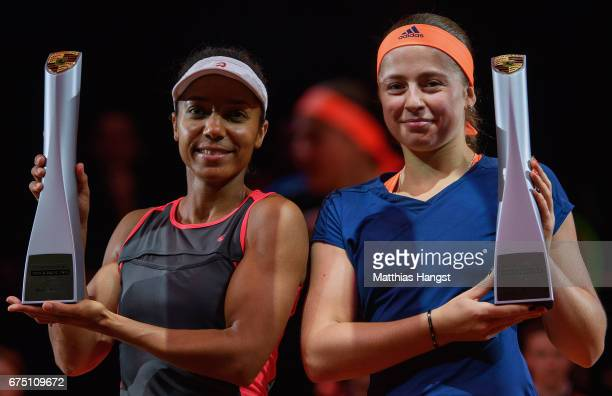 Raquel Atawo of the United States and Jelena Ostapenko of Latvia celebrate with the trophies after the doubles final against Abigail Spears of the...