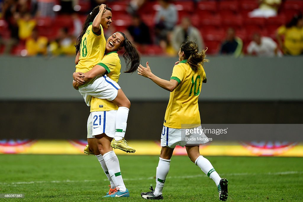 Raquel (#18), Beatriz (#21) and <a gi-track='captionPersonalityLinkClicked' href=/galleries/search?phrase=Marta+-+Soccer+Player&family=editorial&specificpeople=3038337 ng-click='$event.stopPropagation()'>Marta</a> of Brazil celebrate a scored goal against Argentina during a match between Brazil and Argentina as part of International Women's Football Tournament of Brasilia at Mane Garrincha Stadium on December 10, 2014 in Brasilia, Brazil.