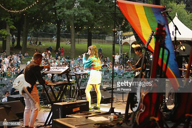 Raquel Berrios and Buscabulla perform with a Rainbow Flag as part of Celebrate Brooklyn at Prospect Park Bandshell on July 9 2016 in New York City