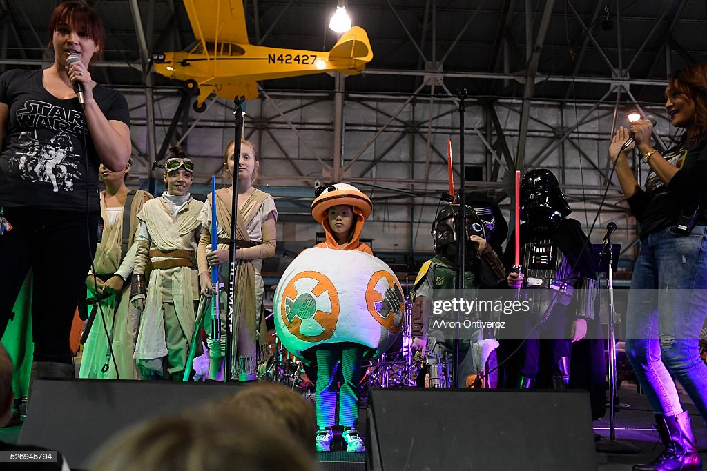 Raquel Bickford, dressed as BB-8, stands with other contestants in the children's costume contest before winning the title and a new lightsaber during a Star Wars themed day at Wings Over the Rockies on Sunday, May 1, 2016.