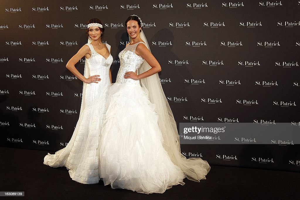Raquel Jimenez (L) and Jessica Bueno showcase designs from the St Patrick new collection on March 4, 2013 in Barcelona, Spain.