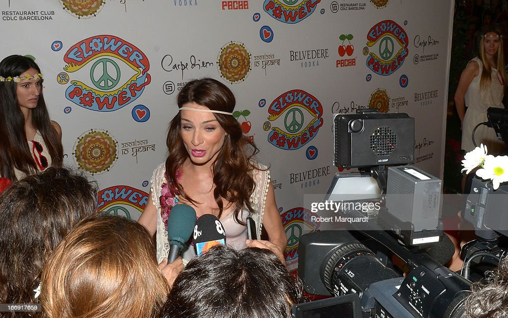 Raquel Jimenez reacts to questions from the media during a photocall for the Flower Power Pacha Party 2013 at the Carpe Diem club on April 18, 2013 in Barcelona, Spain.