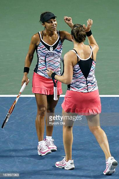Raquel KopsJones and Abigail Spears of the United States celebrate after winning their semi final doubles match against Sabine Lisicki of Germany and...