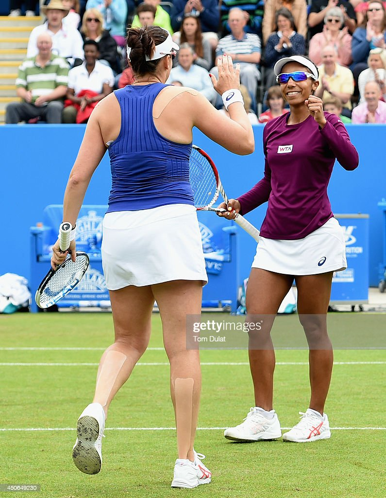 Raquel Kops-Jones and Abigail Spears (L) of the United States celebrate victory in the Doubles Final during Day Seven of the Aegon Classic at Edgbaston Priory Club on June 15, 2014 in Birmingham, England.