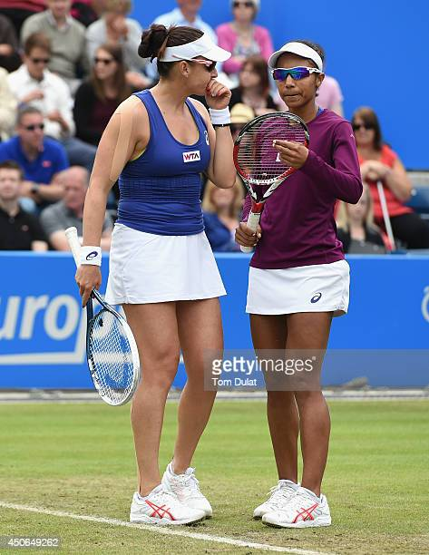 Raquel KopsJones and Abigail Spears of the United States confer during the Doubles Final during Day Seven of the Aegon Classic at Edgbaston Priory...