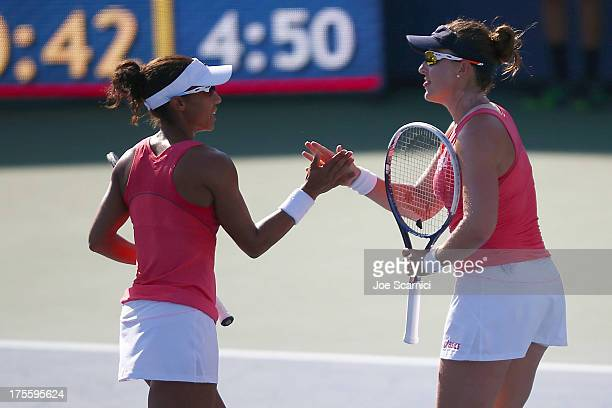Raquel KopsJones and Abigail Spears of the US celebrate a point during the doubles final match against HaoChing Chan of Chinese Taipei and Janette...