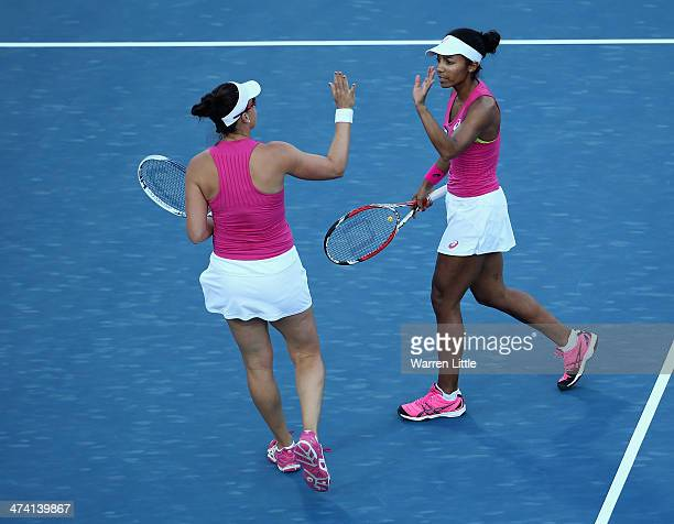 Raquel KopsJones and Abigail Spears of the USA in action against Alla Kudryavtseva of Russia and Anastasia Rodionova of Australia during the doubles...