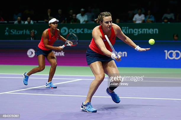 Raquel KopsJones and Abigail Spears of the USA in action against Sania Mirza of India and Martina Hingis of Switzerland during the BNP Paribas WTA...