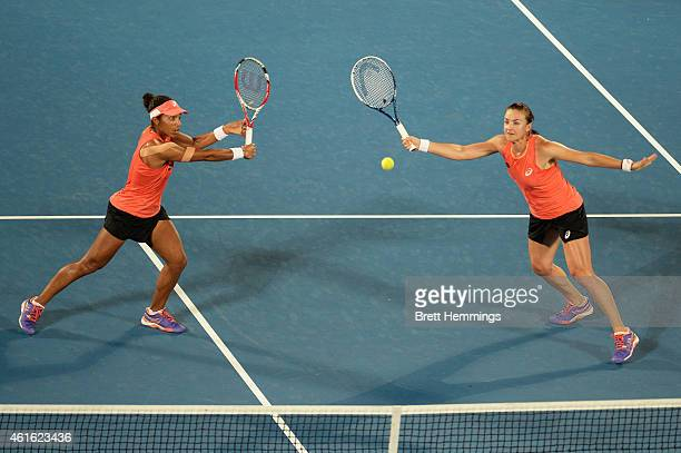 Raquel KopsJones and Abigail Spears of the USA reach for the ball in their doubles final match against Bethanie MattekSands of the USA and Sania...
