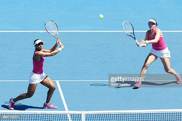 Raquel KopsJones of the United States and Abigail Spears of the United States in action in their fourth round doubles match against Shahar Peer of...