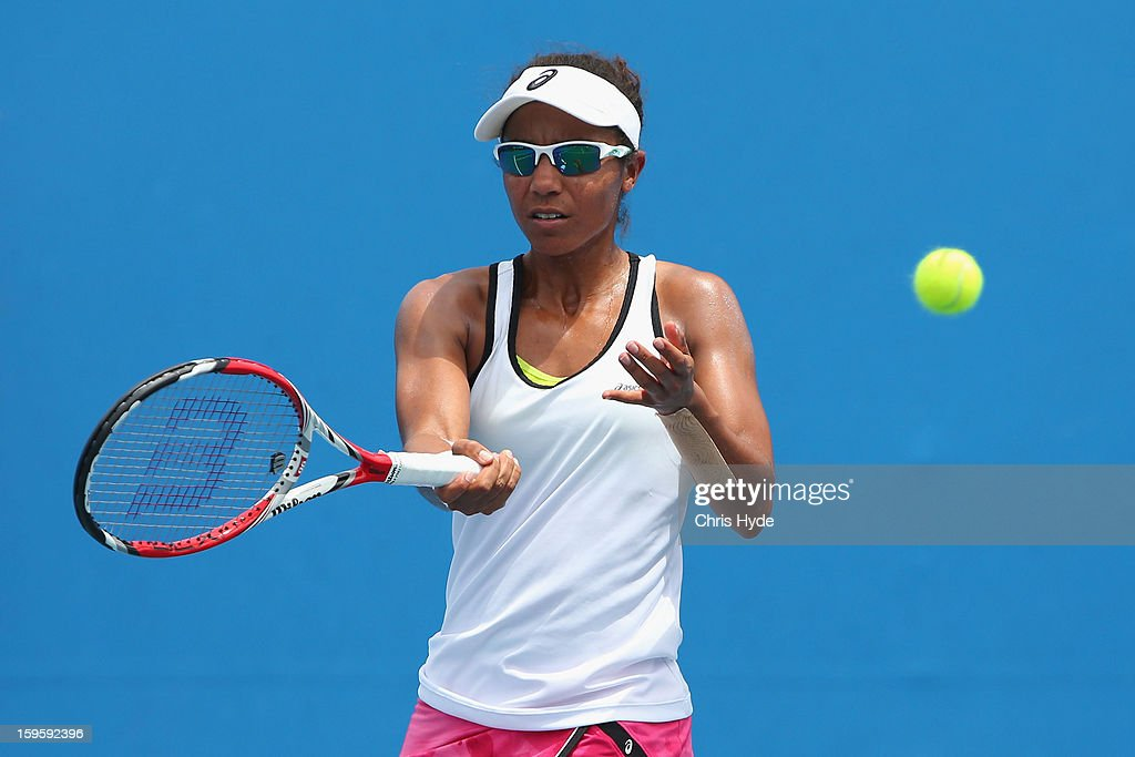 Raquel Kops-Jones of the United States of America plays a forehand in her first round doubles match with Abigail Spears of the United States of America against Kirsten Flipkens of Belgium and Magdalena Rybarikova Slovakia during day four of the 2013 Australian Open at Melbourne Park on January 17, 2013 in Melbourne, Australia.