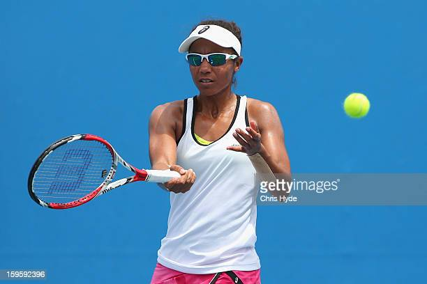 Raquel KopsJones of the United States of America plays a forehand in her first round doubles match with Abigail Spears of the United States of...