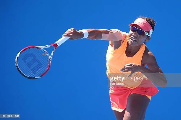 Raquel KopsJones of the United States plays a backhand in their second round doubles match with Abigail Spears of the United States against Vitalia...