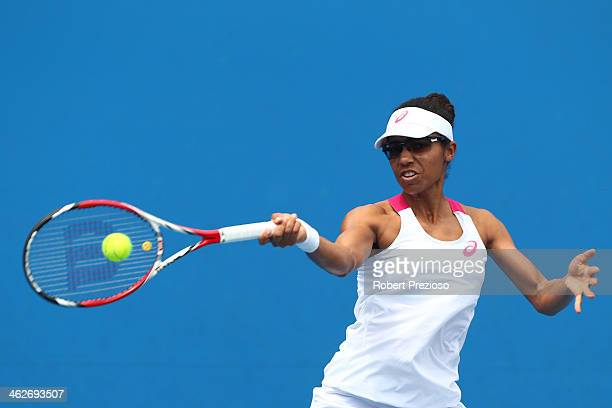 Raquel KopsJones of the United States plays a forehand in her first round doubles match with Abigail Spears of the United States against ChiaJung...