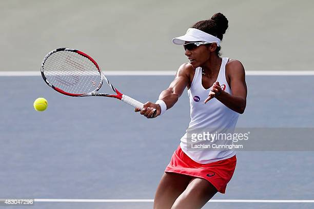Raquel KopsJones of the United States plays in her doubles match with Maria Sanchez of the United States against Mona Barthel and Sabine Lisicki of...