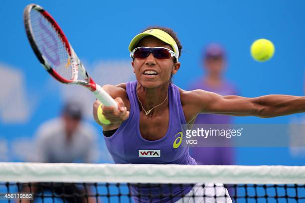 Raquel KopsJones of USA competes against Martina Hingis of Switzerland and Flavia Pennetta of Italy during day six of the 2014 Dongfeng Motor Wuhan...