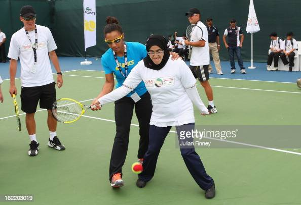 Raquel KopsJones of USA helps with a disabled coaching clinic during day three of the WTA Dubai Duty Free Tennis Championship on February 20 2013 in...
