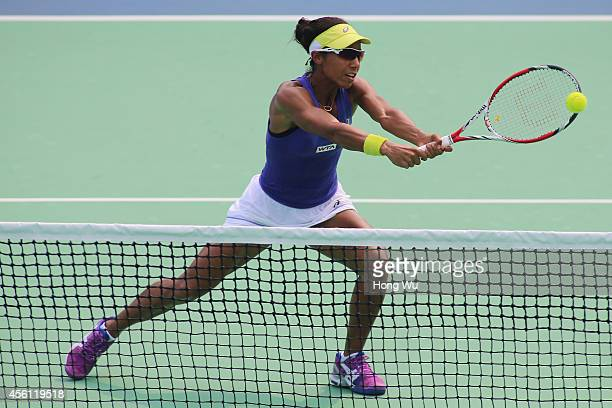Raquel KopsJones of USA in action during the doubles match against Martina Hingis of Switzerland and Flavia Pennetta of Italy on day six of 2014...