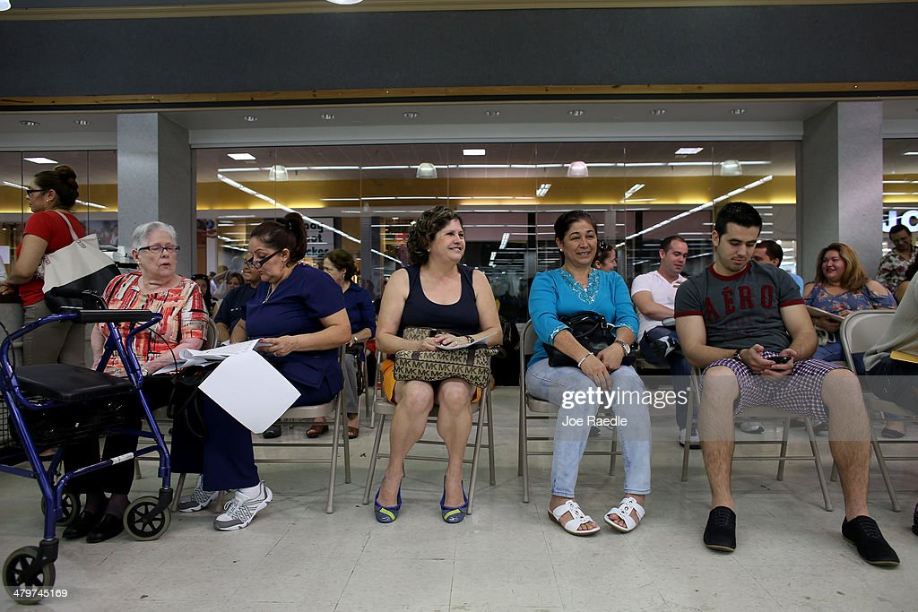Raquel Martinez, Maria Celia Escalona, Flora Motell and Armando Mesa (L-R) wait for their names to be called to speak with an insurance agent from Sunshine Life and Health Advisors as they and others try to purchase health insurance under the Affordable Care Act at a store setup in the Mall of Americas on March 20, 2014 in Miami, Florida. The owner of Sunshine Life and Health Advisors, Odalys Arevalo, said she has seen a surge in people, some waiting up to 3 hours or more in line, trying to sign up for the Affordable Care Act before the open enrollment period for individual insurance ends on March 31.