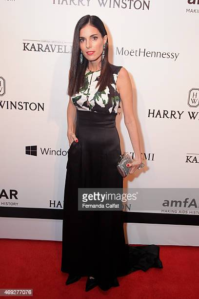 Raquel Oliveira attends the 5th Annual amfAR Inspiration Gala at the home of Dinho Diniz on April 10 2015 in Sao Paulo Brazil