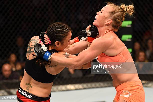 Raquel Pennington punches Holly Holm in their women's bantamweight bout during the UFC 184 event at Staples Center on February 28 2015 in Los Angeles...