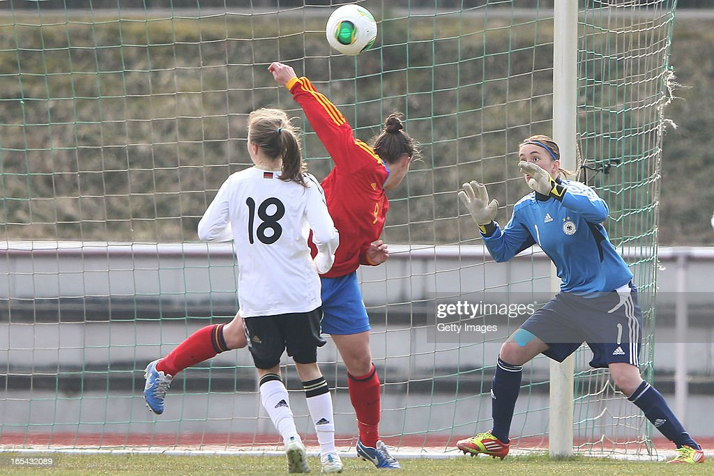 Raquel Pinel Saez of Spain (C) scores her team's first goal against goalkeeper Meike Kaemper (R) and Theresa Panfil (L) of Germany during the Women's UEFA U19 Euro Qualification match between U19 Germany and U19 Spain at Waldstadion in Viernheim on April 4, 2013 in Viernheim, Germany.