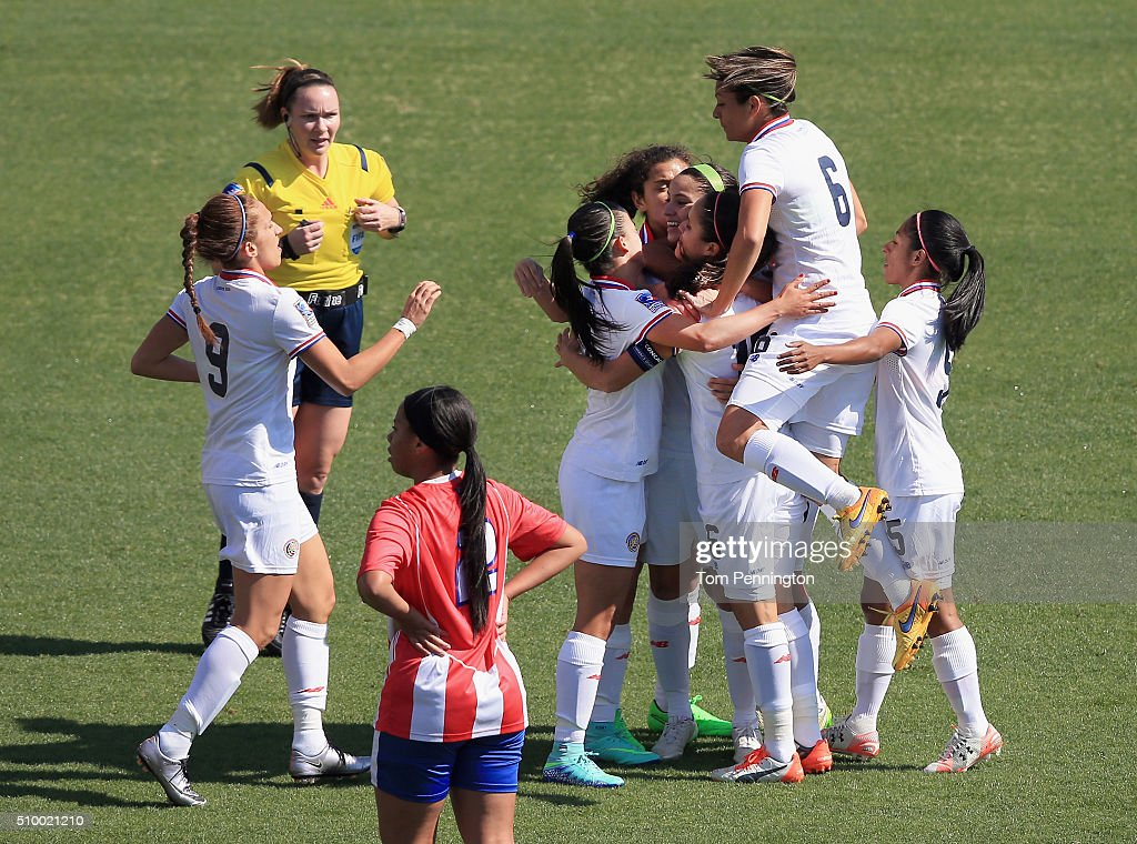 Raquel Rodriguez #11 celebrates with Karla Villalobos #17 of Costa Rica and Carol Sanchez #6 of Costa Rica after scoring a goal agaiinst Puerto Rico in the first half during the Group A - 2016 CONCACAF Women's Olympic Qualifying at Toyota Stadium on February 13, 2016 in Frisco, Texas.