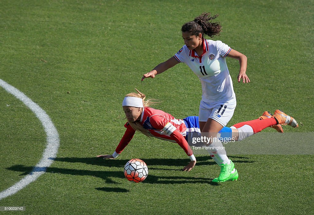 <a gi-track='captionPersonalityLinkClicked' href=/galleries/search?phrase=Raquel+Rodriguez&family=editorial&specificpeople=233702 ng-click='$event.stopPropagation()'>Raquel Rodriguez</a> #11 controls the ball against Delyaliz Rosario #7 of Puerto Rico in the first half during the Group A - 2016 CONCACAF Women's Olympic Qualifying at Toyota Stadium on February 13, 2016 in Frisco, Texas.