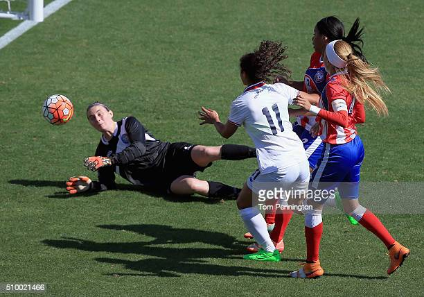 Raquel Rodriguez shoots the ball agaiinst Karly Gustafson of Puerto Rico in the first half during the Group A 2016 CONCACAF Women's Olympic...