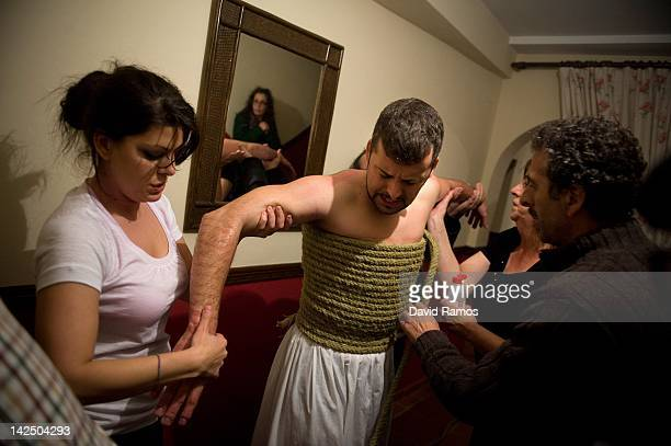 Raquel sister of Feliciano and his father Chano massage the arms of Feliciano Isaac aged 31 helping to recover the circulation of blood after he had...