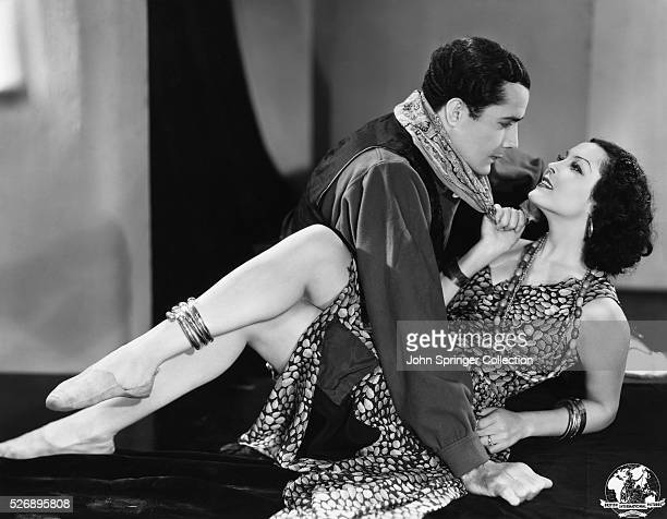 Raquel Torres as Sheba Price and Don Alvarado as Davey Heron in a scene from the 1934 British International Picture Red Wagon adapted from the novel...
