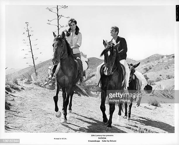 Raquel Welch and Anthony Franciosa riding horses in a scene from the film 'Fathom' 1967