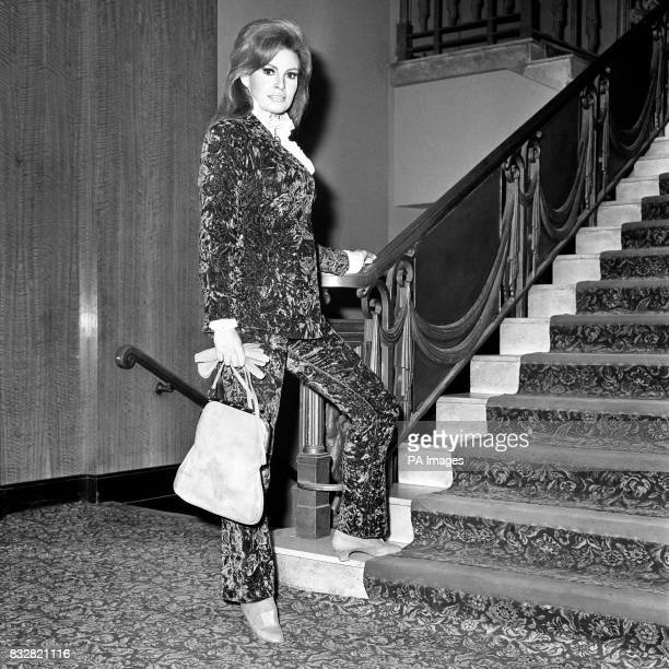 Raquel Welch wears a patterned velvet trouser suit for a gala opening of the film Murderers Row at the Leicester Square Theatre