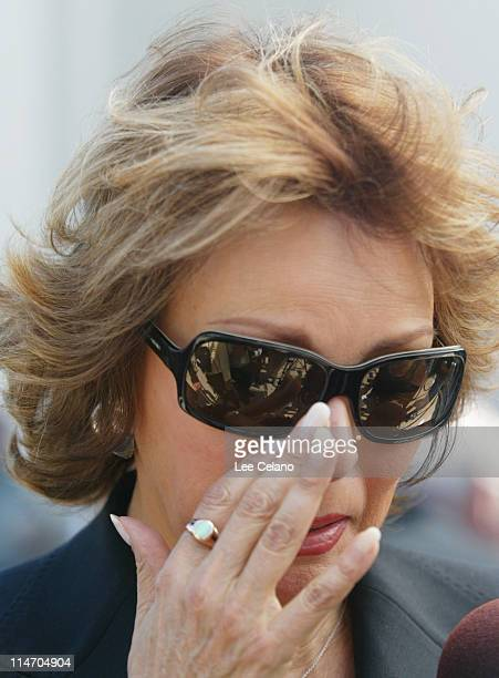 Raquel Welch wipes away tears as she departs a memorial service for Bob Hope at St Charles Borromeo Catholic Church in the North Hollywood section of...