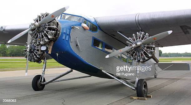 A rare allmetal Ford TriMotor plane sits on the Ford test track after it landed at the Dearborn Proving Ground June 9 2003 in Dearborn Michigan The...